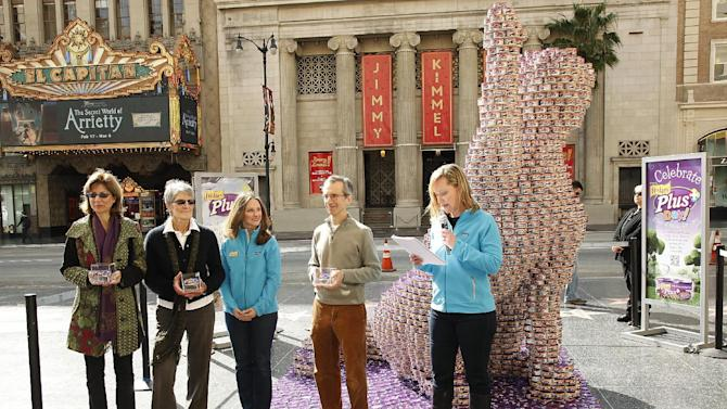 "(from the left) Vice President of Kitt Crusaders Nelia Southwick ,Salli Sammut, Vice President of the Lange Foundation, Kamila Nelson Friskies brand rep, Ben Lehrer, President of Kitten Rescue and Julie Voss Catron; pose for a photo by the nearly 10-foot tall, six-foot wide Friskies Plus Catstruction sculpture is seen on Hollywood Boulevard on Wednesday, Feb. 29, 2012 in Los Angeles. Friskies celebrates Leap Day 2012, Feb. 29, as ""Plus Day,"" a day of extras for cats. The sculpture features thousands of cans of Friskies Plus cat food, which will be donated to three Los Angeles cat rescue and adoption organizations. (Joe Kohen /AP Images for Friskies)"