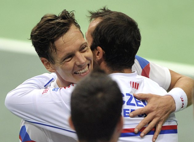 Berdych and Stepanek share a man-hug after their win over the Netherlands earlier this year. (AP Photo,CTK/Jaroslav Ozana)