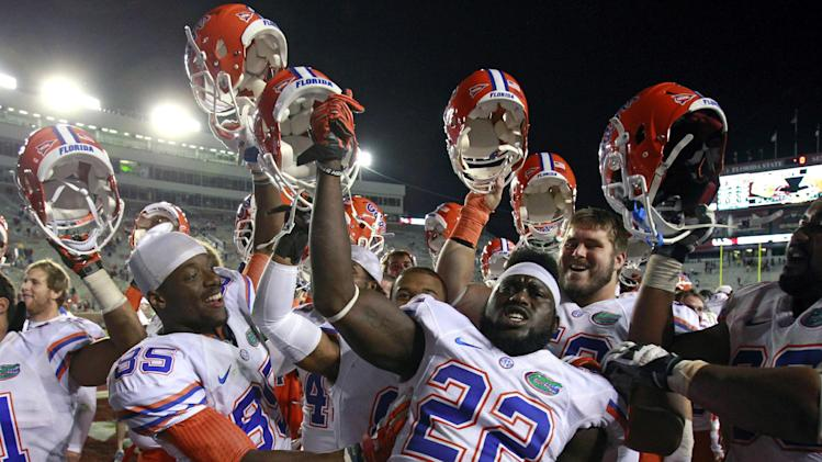 Florida players celebrate after defeating Florida State 37-26 in an NCAA college football game, Saturday, Nov. 24, 2012, in Tallahassee, Fla. (AP Photo/John Raoux)
