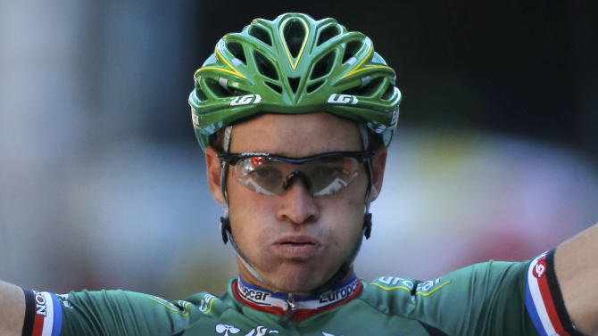 Thomas Voeckler of France crosses the finish line to win the 16th stage of the Tour de France cycling race over 197 kilometers (122.4 miles) with start in Pau and finish in Bagneres-de-Luchon, France, Wednesday July 18, 2012. (AP Photo/Laurent Rebours)