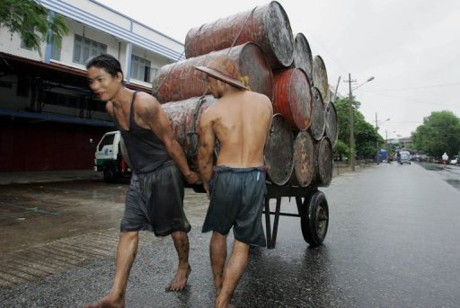 <p>Local laborers are seen pulling a cart loaded with drums to be filled with diesel on the outskirts of Yangon, in 2005. US senators said on Wednesday they planned to move quickly to confirm the first US ambassador to Myanmar in two decades, as they pushed to allow investment in the country's oil and gas sector.</p>