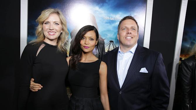 VP of DirecTV Entertainment and General manager of audience network Patty Ishimoto, Thandie Newton and SVP of DirecTV Entertainment Chris Long at the Los Angeles Premiere of DirecTV original series ROGUE, on Tuesday, March, 26, 2013 in Los Angeles held at Arclight Hollywood. (Photo by Eric Charbonneau/Invision for Sunshine Sachs/AP Images)