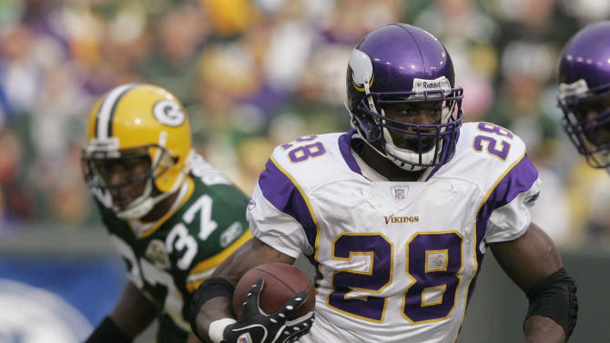 FILE - In this Nov. 11, 2007, file photo, Minnesota Vikings running back Adrian Peterson (28) moves the ball during the first half of an NFL football game against the Green Bay Packers in Green Bay, Wis. Peterson has won The Associated Press 2012 NFL Offensive Player of the Year award just one year after major knee surgery. (AP Photo/Morry Gash, File)