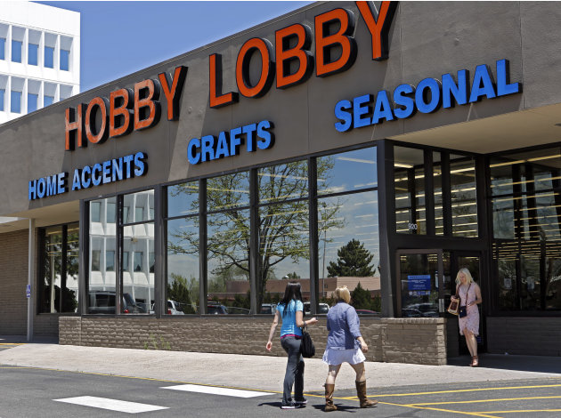 Customers are seen at a Hobby Lobby store in Denver on Wednesday, May 22, 2013.  A challenge to the federal health care law faces its most prominent test yet in a full 10th Circuit hearing in Denver o