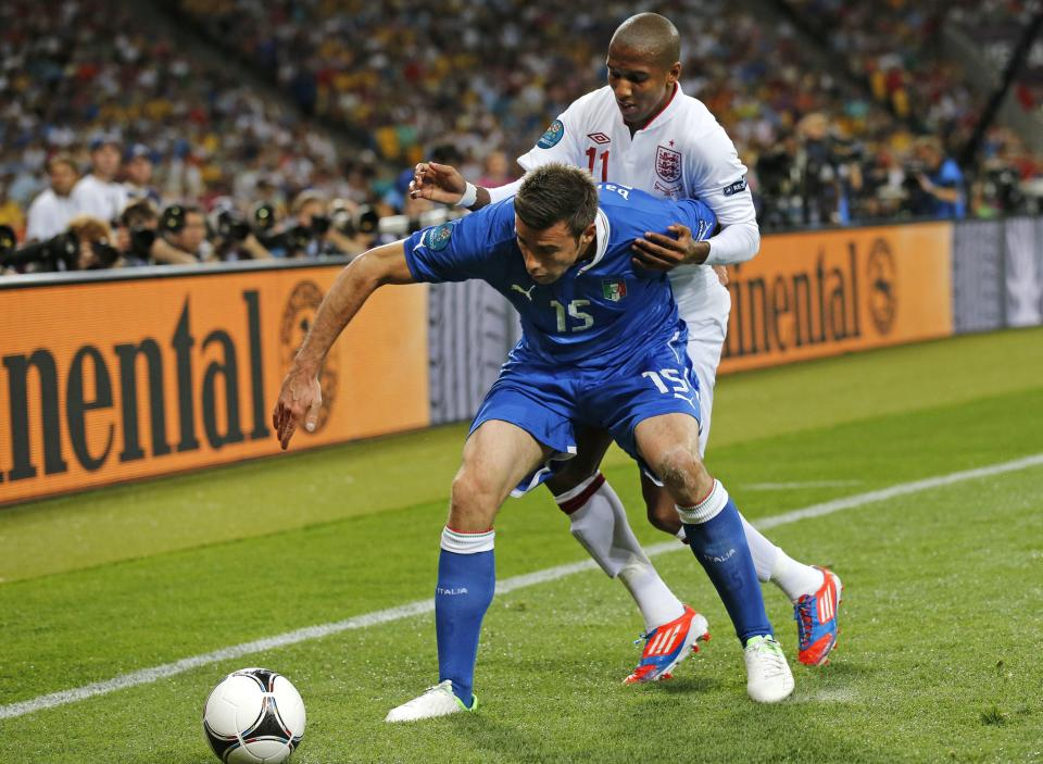 Italy's Andrea Barzagli holds back England's Ashley Young during the Euro 2012 soccer championship quarterfinal match between England and Italy in Kiev, Ukraine, Sunday, June 24, 2012. (AP Photo/Gregorio Borgia)
