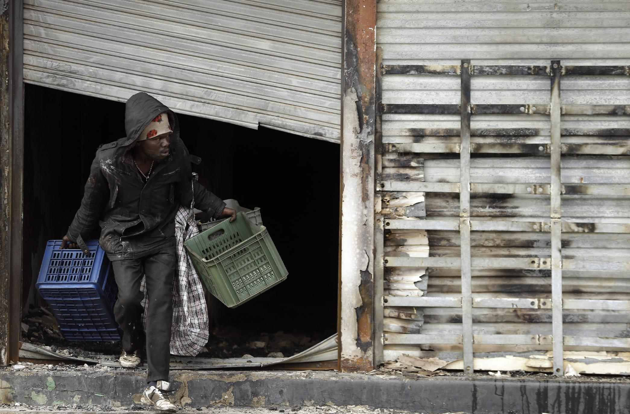 Immigrants describe threats in South Africa