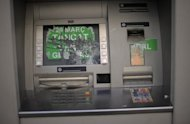 A damaged ATM in Barcelona. Bad loans held by Spain's crisis-torn lenders soared to its highest level in 50 years in July with nearly one in ten loans deemed at risk