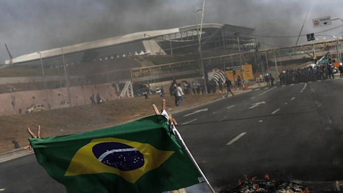 File photo of a member of Brazil's Homeless Workers' Movement blocking a road during a protest in front of Sao Paulo's World Cup stadium