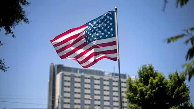 FILE - In this May 24, 2013, file photo, an American flag flies in front of the Atlanta VA Medical Center in Atlanta. After two overwhelming votes in two days, congressional lawmakers say they are confident they can agree on a bill to improve veterans' health care and send it to the president's desk by the end of the month. (AP Photo/David Goldman, File)