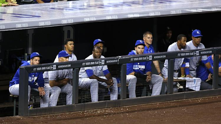 Members of the Kansas City Royals sit in the dugout in the top of the ninth inning against the Colorado Rockies during a baseball game Wednesday, Aug. 20, 2014, in Denver. The Rockies won 5-2. (AP Photo/Jack Dempsey)