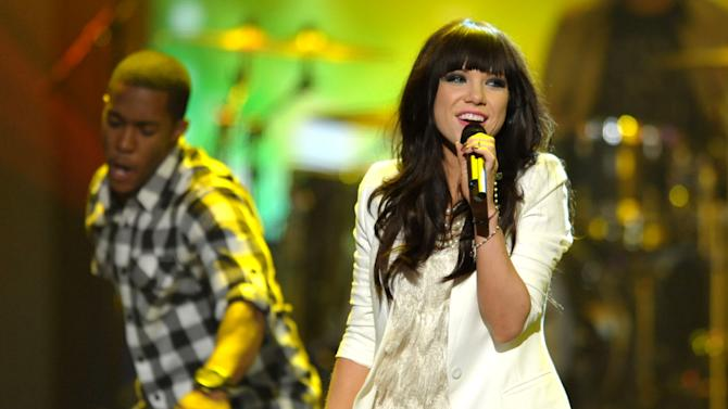"FILE - This Nov. 18, 2012 file photo shows Carly Rae Jepsen performing at the 40th Annual American Music Awards in Los Angeles. The song put 27-year-old Jepsen, who finished third on a season of ""Canadian Idol,"" in the spotlight and on a path to potential Grammy gold. The monster hit is nominated for song of the year and best pop vocal performance at the Feb. 10 awards show. (Photo by John Shearer/Invision/AP)"