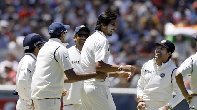 Indian players celebrate after Ishant Sharma bowled out Micahel Clarke of Australia during the third day of the first test match at the Melbourne Cricket Ground in Melbourne, Australia, on Wednesday Dec. 28, 2011. (AP Photo/Andrew Brownbill)