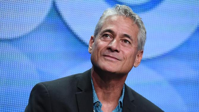 """Greg Louganis speaks onstage during the """"Back on Board: Greg Louganis"""" panel at the HBO 2015 Summer TCA Tour held at the Beverly Hilton Hotel on Thursday, July 30, 2015, in Beverly Hills, Calif. (Photo by Richard Shotwell/Invision/AP)"""