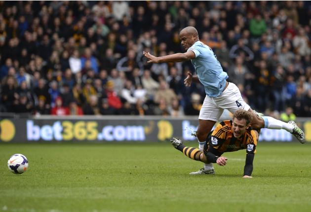 Manchester City's Kompany fouls Hull City's Jelavic during their English Premier League soccer match in Hull