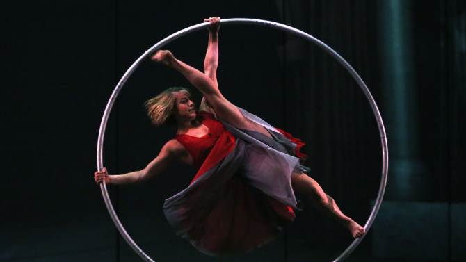 Performer Lea Toran Jenner balances inside a spinning hoop during a dress rehearsal for the Canadian acrobatic troupe Cirque Eloize's new show titled 'Cirkopolis' at the Sydney Opera House