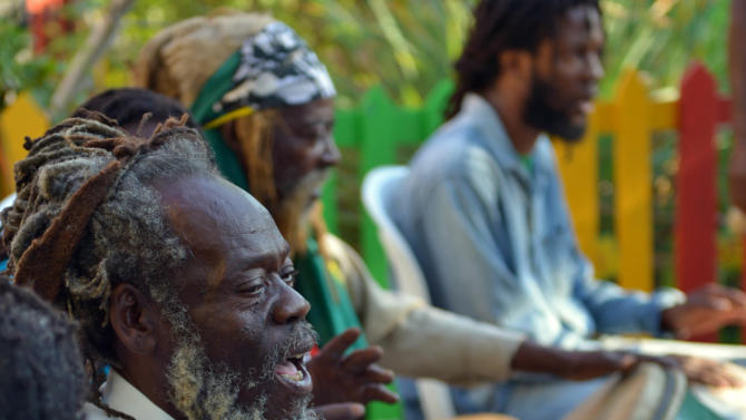 A Rastafarian drummer leads a chant during the celebration of reggae music icon Bob Marley's 68th birthday in the yard of his Kingston home, in Jamaica, Wednesday, Feb. 6, 2013. Marley's relatives and old friends were joined by hundreds of tourists to dance and chant to the pounding of drums to honor the late reggae icon who died of cancer in 1981 at age 36. (AP Photo/David McFadden)