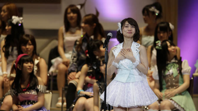 FILE - In this June 6, 2012 file photo, Japan's all-girl pop idol group AKB48 member Yuko Oshima reacts after winning the annual AKB48 popularity poll in Tokyo. Oshima, the winner two years ago, returned to the top seat in the vote - by almost 1.4 million fans this year - to determine who gets to record their next single - which inevitably becomes a hit. (AP Photo/Shizuo Kambayashi, File)