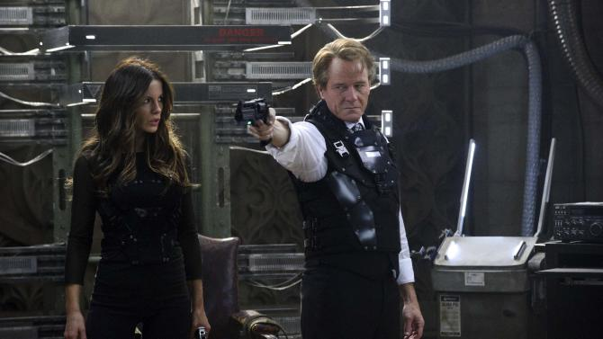 "This film image released by Columbia Pictures shows Kate Beckinsale, left, and Bryan Cranston in a scene from the action thriller ""Total Recall.""  (AP Photo/Columbia Pictures - Sony, Michael Gibson)"
