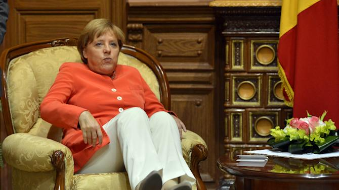German Chancellor, Angela Merkel, takes her seat in an armchair of the presidential office in Chisinau, Moldova, Wednesday, Aug. 22, 2012. Merkel has urged Moldova to continue democratic reforms and fight corruption during a one-day visit to the former Soviet republic. (AP Photo/dapd, Oliver Lang)