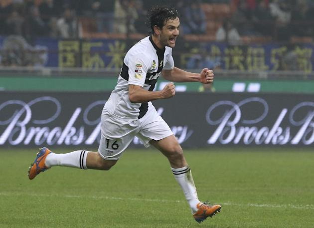Parma midfielder Marco Parolo celebrates after scoring during the Serie A soccer match between Inter Milan and Parma at the San Siro stadium in Milan, Italy, Sunday, Dec. 8, 2013