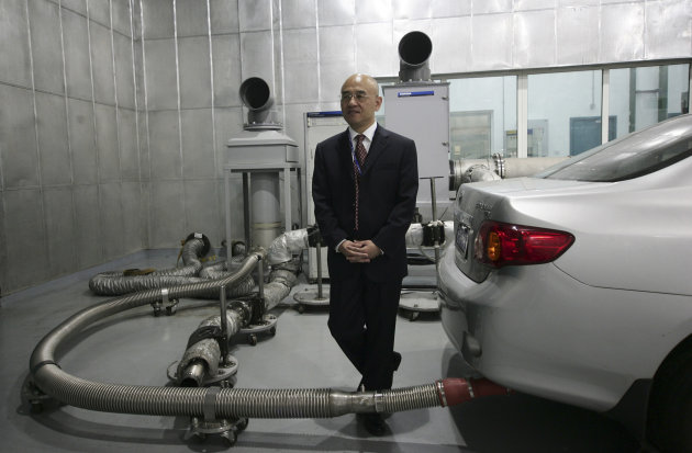 China-born U.S. scientist Hu Zhicheng walks at his work place Friday Sept. 30, 2011 in Wuxi, China. In the year-plus since he was released from jail, scientist Hu has been free, free to drive from his Shanghai apartment to his office two hours away, free to get acupuncture treatment for chronic back pain, free except to leave China and rejoin his family in America. (AP Photo)