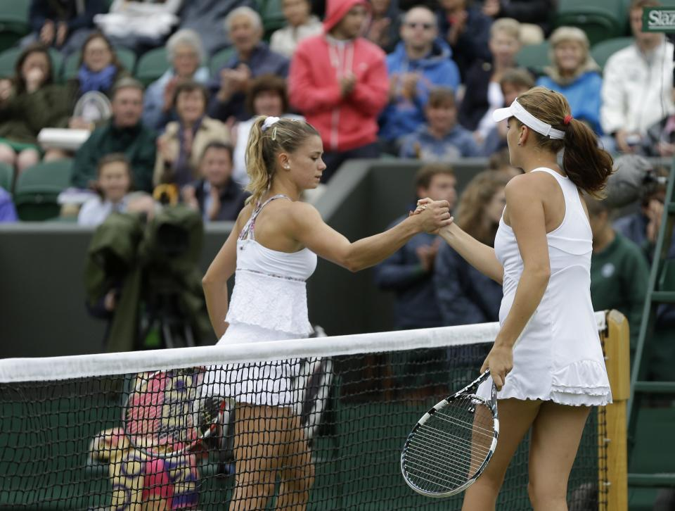 Agnieszka Radwanska of Poland, right, is congratulated by Camila Giorgi of Italy after she won a fourth round singles match at the All England Lawn Tennis Championships at Wimbledon, England, Monday, July 2, 2012. (AP Photo/Kirsty Wigglesworth)