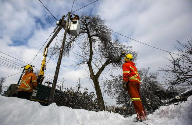 Toronto Hyrdro workers work to restore power following an ice storm in Toronto