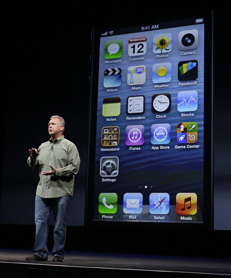Phil Schiller, Apple's senior vice president of worldwide marketing, speaks on stage during an introduction of the new iPhone 5 at an Apple event in San Francisco, Wednesday Sept. 12, 2012. (AP Photo/Eric Risberg)