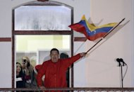 Venezuelan President Hugo Chavez addresses supporters after receiving news of his reelection in Caracas on October 7. Chavez shrugged off cancer and a unified opposition to triumph yet again at the ballot box and claim another six-year term