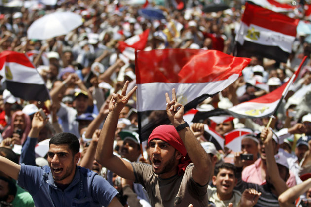 Egyptian protesters chant slogans and wave national flags during a rally in Tahrir Square in Cairo, Egypt, Friday, April 20, 2012. Tens of thousands of protesters packed Cairo's downtown Tahrir Square