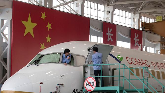 An almost completed COMAC ARJ21-700 passenger jet is shown at a final assembly and manufacturing centre in Shanghai, May 21, 2014