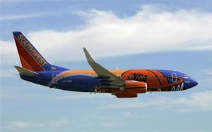 A Southwest Airlines passenger aircraft painted with a new NBA logo theme arrives at Love Field airp..