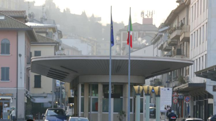 Vehicles drive through the Swiss-Italian border with Como in Chiasso
