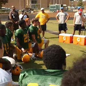 Johnson surprises high school football team