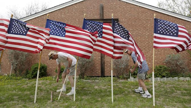 Bob Butler, left, and Bob Gordon, right, work or a memorial at Central Christian Church for the victims of a Fort Hood shooting, Thursday, April 3, 2014, in Killeen, Texas. A soldier, Spc. Ivan Lopez, opened fire Wednesday on fellow service members at the Fort Hood military base, killing three people and wounding 16 before committing suicide. (AP Photo/Eric Gay)