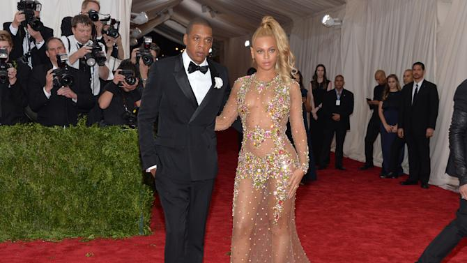 """Jay-Z, left, and Beyonce arrive at The Metropolitan Museum of Art's Costume Institute benefit gala celebrating """"China: Through the Looking Glass"""" on Monday, May 4, 2015, in New York. (Photo by Evan Agostini/Invision/AP)"""