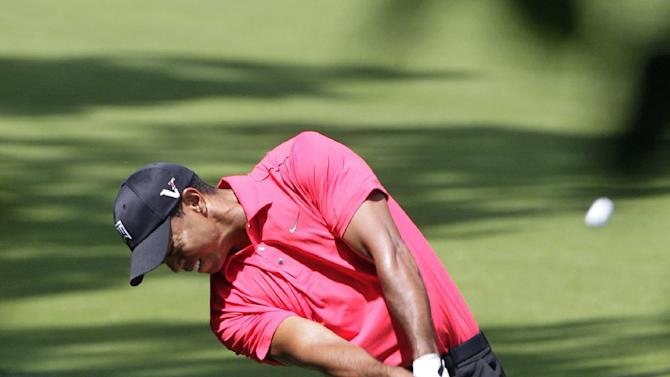 Tiger Woods hits his second shot on the ninth hole during the final round of the Memorial golf tournament on Sunday, June 3, 2012, in Dublin, Ohio. Woods parred the hole. (AP Photo/Jay LaPrete)