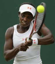 Sloane Stephens of the United States returns a shot against Petra Cetkovska of the Czech Republic  during a second round women&#39;s singles match at the All England Lawn Tennis Championships at Wimbledon, England, Wednesday, June 27, 2012. (AP Photo/Alastair Grant)