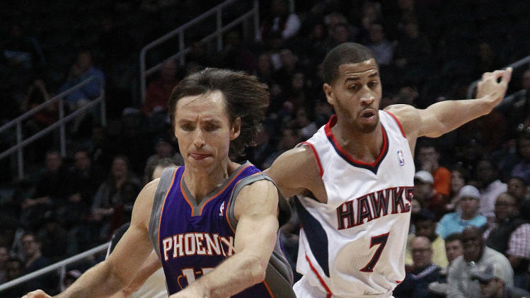 Phoenix Suns guard Steve Nash (13) drives past Atlanta Hawks guard Jannero Pargo (7) in the fourth quarter of an NBA basketball game Monday, Feb. 6, 2012, in Atlanta. The Suns won 99-90. (AP Photo/John Bazemore)