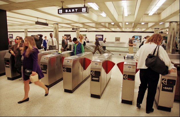 FILE - Commuters enter and exit a Bay Area Rapid Transit station in San Francisco&#39;s financial district in this Sept. 15, 1997 file photo. Officials with the Bay Area Rapid Transit system, better known as BART, said Friday Aug. 12, 2011 that they blocked cellphone reception in San Francisco train stations for three hours to disrupt planned demonstrations over a police shooting. (AP Photo/Robin Weiner, File)