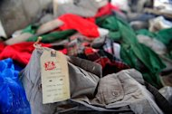 Items of clothing lie in the rubble of a collapsed garment factory in Savar, on the outskirts of Dhaka, on May 2, 2013. International workers' associations such as Swiss-based UNI and IndustriALL Global Union have pressured Western retailers to sign up to a legally binding agreement committing them to independent building and fire safety inspections