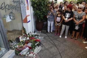 People gather at the site where Fissas was stabbed to death, by man who sympathized with far-right Golden Dawn group, at Keratsini suburb southwest of Athens