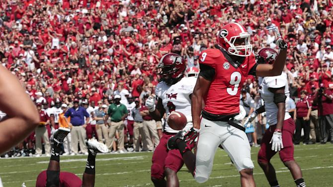 Georgia wide receiver Kenneth Towns (9) runs past Troy linebacker Mark Wilson (35) to score a touchdown in the first half of an NCAA college football game, Saturday, Sept. 20, 2014, in Athens, Ga. (AP Photo/John Bazemore)