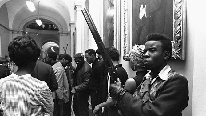 FILE - In this May 2, 1967 file photo taken by Walt Zeboski, armed members of the Black Panthers Party stand in the corridor of the Capitol in Sacramento today, May 2, 1967. They were protesting a bill before an Assembly committee restricting the carrying of arms in public.  Zeboski, who chronicled Ronald Reagan's 1980 presidential campaign and a succession of California governors as a photographer for The Associated Press, has died. He was 83. (AP Photo/Walt Zeboski, File)