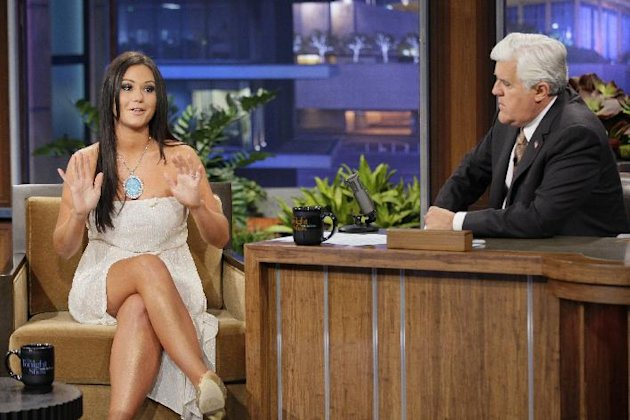 "This Oct. 30, 2012 photo released by NBC shows Jenni ""JWoww"" Farley, a cast member in the reality series ""Jersey Shore,"" left, and host Jay Leno on ""The Tonight Show with Jay Leno,"" in Burbank, Calif. Seaside Heights, the New Jersey town that for millions made ""Jersey Shore"" synonymous with Snooki was among the hardest hit by Superstorm Sandy and its famous summer residents sent their prayers to those affected. Farley and fellow cast members Paul ""Pauly D"" DelVecchio, Vinny Guadagnino asked their Twitter followers to donate to the American Red Cross. (Photo by: Paul Drinkwater/NBC)"