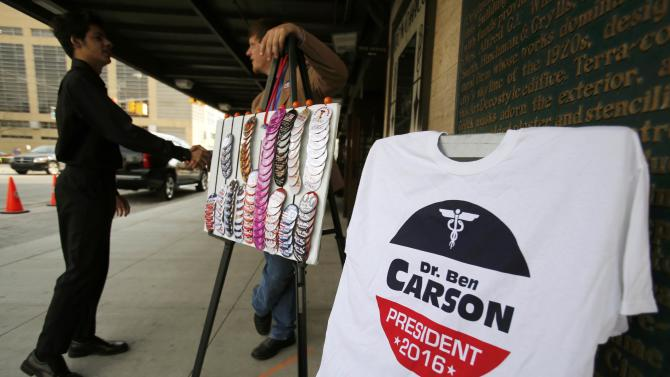 A man sells t-shirts and buttons before Republican U.S. presidential candidate Carson officially launched his candidacy in Detroit
