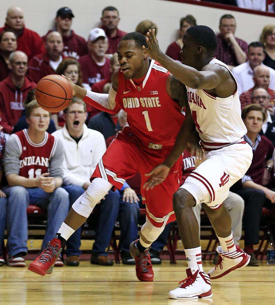 Ohio State's Deshaun Thomas (1) drives to the basket against Indiana's Victor Oladipo (4) during the first half of an NCAA college basketball game, Tuesday, March 5, 2013, in Bloomington, Ind. (AP Photo/Darron Cummings)