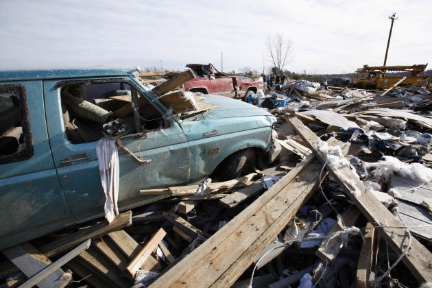 Wrecked vehicles and debris are seen following a tornado where several people died, in East Bernstadt, Kentucky