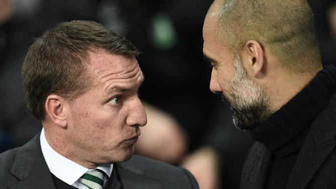 Brendan Rodgers (left) greets Pep Guardiola at the Etihad Stadium in Manchester on December 6, 2016