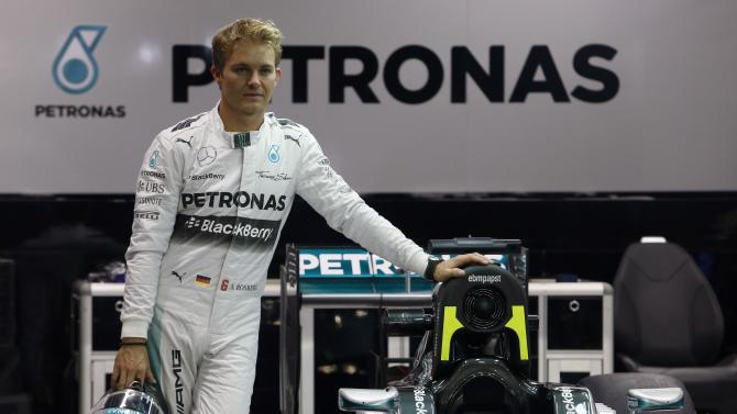 Mercedes Formula One drivers Nico Rosberg of Germany poses for photos in their garage ahead of the Singapore F1 Grand Prix night race